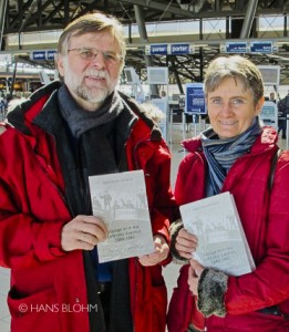 "Hartmut Lutz and France Rivet at the Ottawa airport holding copies of the book ""Voyage with the Labrador Eskimos, 1880-1881"" shortly after it was printed."