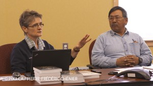 France Rivet and Johannes Lampe, Nain's chief elder, presenting the findings to the elders' committee.