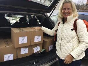 Rozanne Enerson Junker with boxes of Renatus' Kayak