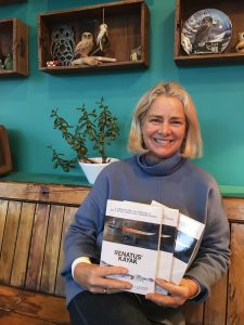 Rozanne Enerson Junker holding her new book, Renatus' Kayak